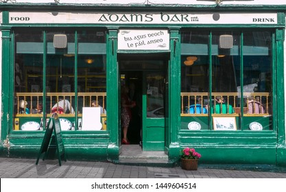 Dingle, County Kerry/Ireland: August 31th, 2013: Typical Irish pub facade with some people  inside.