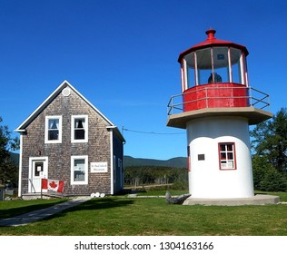 Dingwall, Nova Scotia, Canada - September 21, 2017: Saint Paul Island Museum and Lighthouse on the Cabot Trail in Cape Breton Highlands National Park that memorializes Canada's maritime history