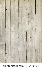 Dingy Grey Barn Wooden Wall Planking Vertical Texture. Old Solid Wood Slats Rustic Shabby Gray Background. Hardwood Dark Weathered Vintage Surface. Grungy Faded Timber Wood Rough Exterior Structure.