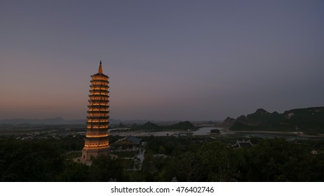 Dinh Pagoda complex in late evening with illuminated high tower temple. Sightseeing of Vietnam
