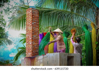 Dinh Yen weaving mat village, Dong Thap province, Vietnam - May 10, 2017 - They dye the Cyperus bundles with many colors to weave the sleeping mats