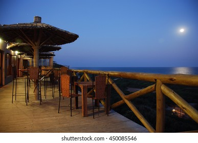 Dining area in the moonlight on the coast