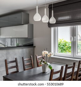 Dining Area With Table Wooden Chairs And Decorative Window Roller Blind