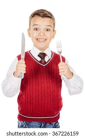 Dining concept. Portrait Hungry Boy holding cutlery fork and knife on hand, hungry for food on white studio background.