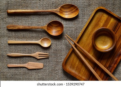 Dining equipment made of wood such as spoons on sackcloth.
