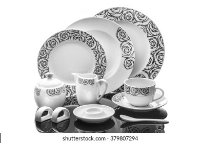dining porcelain set of plates, cup and napkin ring with ornament isolated on white background, product photography, serving set
