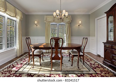 Dining room with decorative rug and buffet
