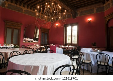 Dining room in the hall of an ancient castle.