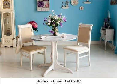 dining room interior with flowers decorative plates blue wall an
