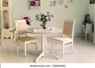 dining room interior with flowers decorative plates on  wall and tea cup