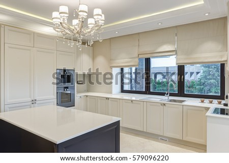 Dining Room With Kitchen Bar Of The Center And Chandelier Over In