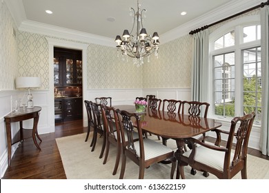Dining room in luxury home with adjacent bar.