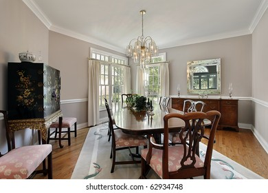 Dining room in luxury home with gray carpet