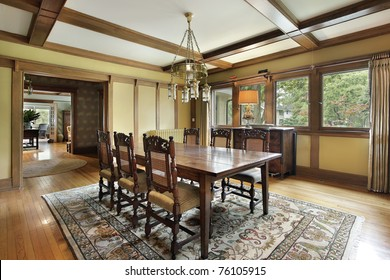 Dining room in luxury home with wood beam ceilings