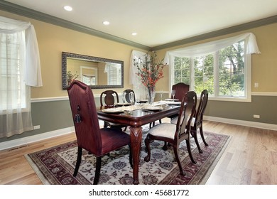 Dining room in new construction home with yellow and green walls
