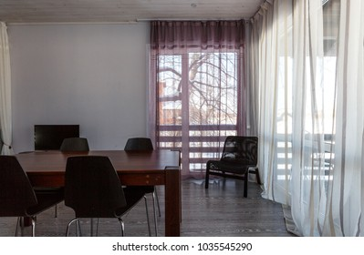 Dining room with panoramic windows and wooden floor and ceiling