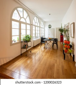 Dining room in renovated design apartment. Large arched windows.