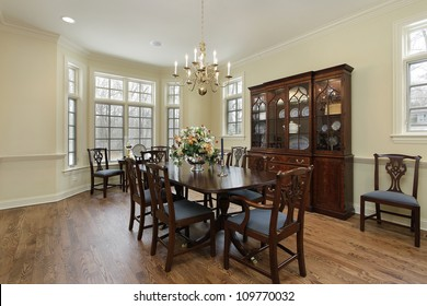 Dining room in suburban home with cream colored walls