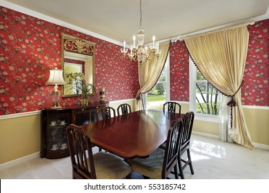 Dining room in suburban home with flowered wallpaper.