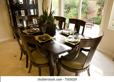 Dining room and table with festive decor.