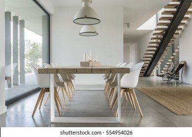 Dining room with window, ceiling lamp and stairs