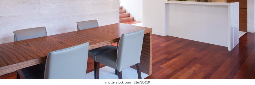 Dining room with wooden table and floor