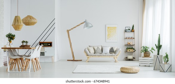 Dining space with table and chairs in living room with sofa