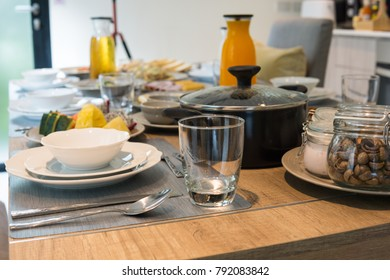 Dining table with accessories such as glass, spoon and fork.