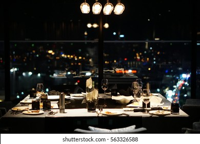 Dining table after dinner : dine fine restaurant. Table setting for celebration. Luxury table settings for fine dining with and glassware, beautiful blurred background. Preparation for holiday.