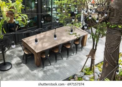 Dining table in backyard garden Focus on bulb