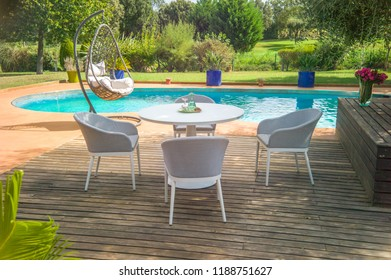 Dining table with chairs and table appointments for 4 persons.