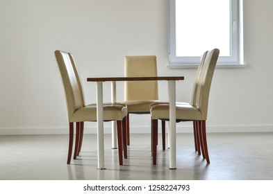 Dining table and chairs in light kitchen