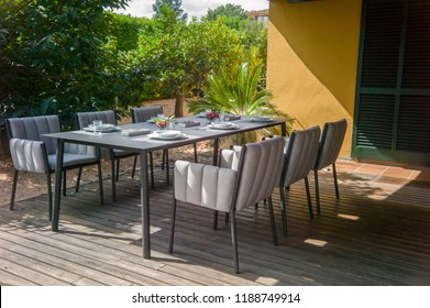 Dining table with chairs and serving for 6 people.