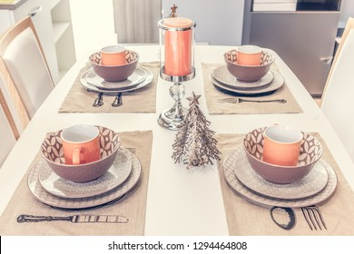 Dining table with contemporary tableware and festive decor