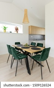 Dining table next to kitchen in contemporary house