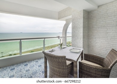 Dining table on the balcony. Sea view.