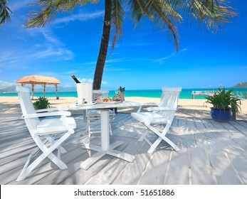 Dining table on the beach close to the ocean
