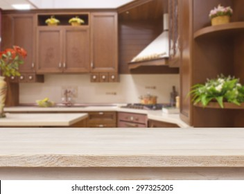Dining table on blurred brown kitchen interior background