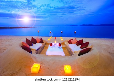 Dining table in the sand close to the ocean.dig the sand to do the dining table and over looking to Koh Phangan Samui Thailand