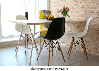 Dining table with set of chairs.