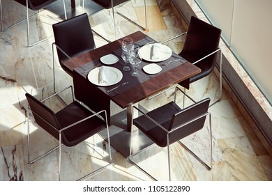 dining table set with dishes in a restaurant