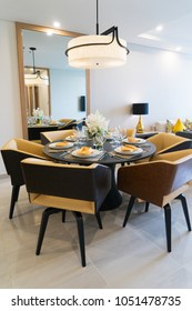 Dining table setting for dinner party at home. Cozy comfortable dining area with stylish arrangement on table. Home concept