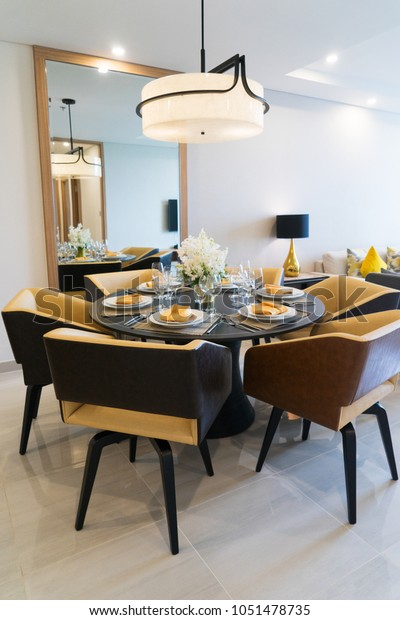 Dining table setting for dinner party at home. Cozy comfortable dining area with stylish arrangement & Dining Table Setting Dinner Party Home Stock Photo (Edit Now) 1051478735