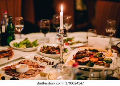 A dining table with tasty food in restaurant