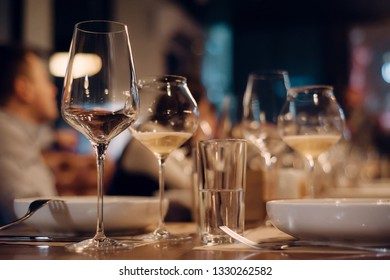 dinner background with biodynamic wine glasses and plates. copy space
