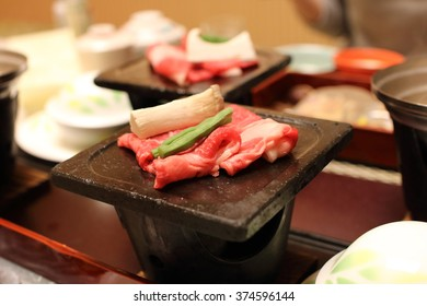Dinner at a Japanese-style inn with a hot spring. The meat dish baked by a slate.