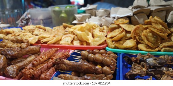 """Dinner, on sidewalks sold on the roadside or angkringan """"with a variety of satay and fried foods"""