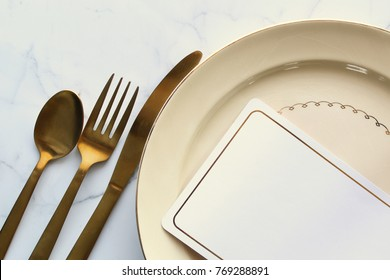 Dinner place setting with blank notecard. Copy space.
