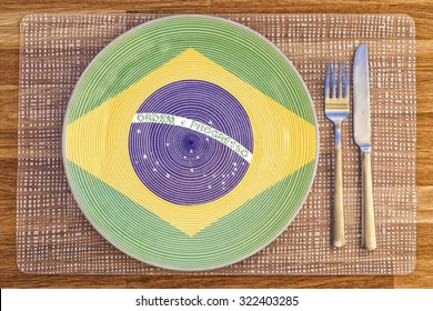 Dinner plate with the flag of Brazil on it for your international food and drink concepts.