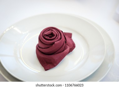 Dinner plates with napkin folded in shape of rose